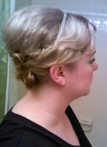 I took a silver necklace, put bobby pins on either side, and hooked it into my hair like a little headband.  I used two more pins on each side to secure it, hiding the pins under the side waves.