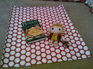 My next trial was to wrap up a plush Bilbo Baggins with The Hobbit.