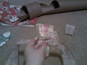 Then, start peeling back the petals of your ribbon and fluffing them up.