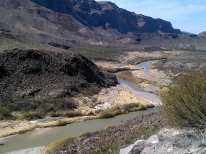 From the middle of the river (the Rio Grande), the left side of the photo is Mexico.  The right side is Texas.