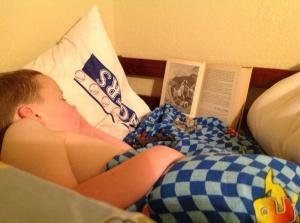 Here is Thor, having bored himself to sleep, reading Genesis.