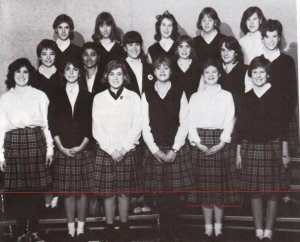That's me Freshman year.  I'm on the bottom row, second from right.  You'll note how much longer my skirt was than the average, and how much shorter my hair.